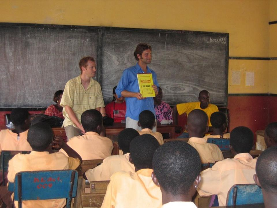 Two guys teaching in Ghana