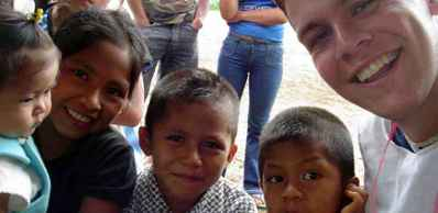 A Volunteer in Ecuador With a Bunch of Kids